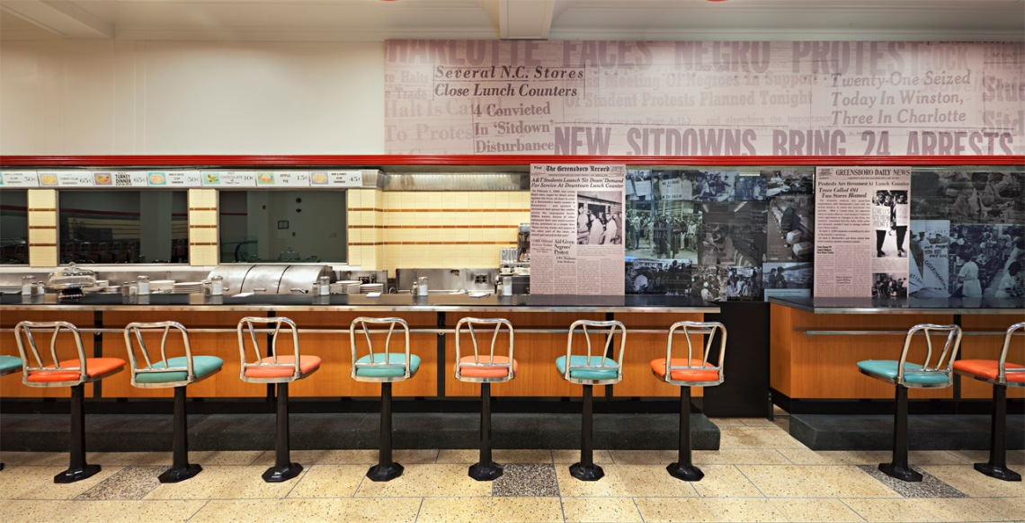 The lunch counter exhibit at the International Civil Rights Center & Museum in Greensboro, NC. Photo via ArchDaily.