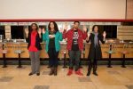 Four new digital citizens stand in front of the lunch counter at the ICRC&M 55 years after four A&T students launched the 1906s sit in movement. Left to right: Alexis Anderson, April Parker, Irving Allen, and Kristen Jeffers. Photo by Stephen Charles.